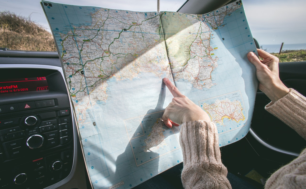 pointing at a map